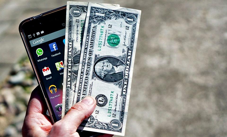 smartphone and money dollars