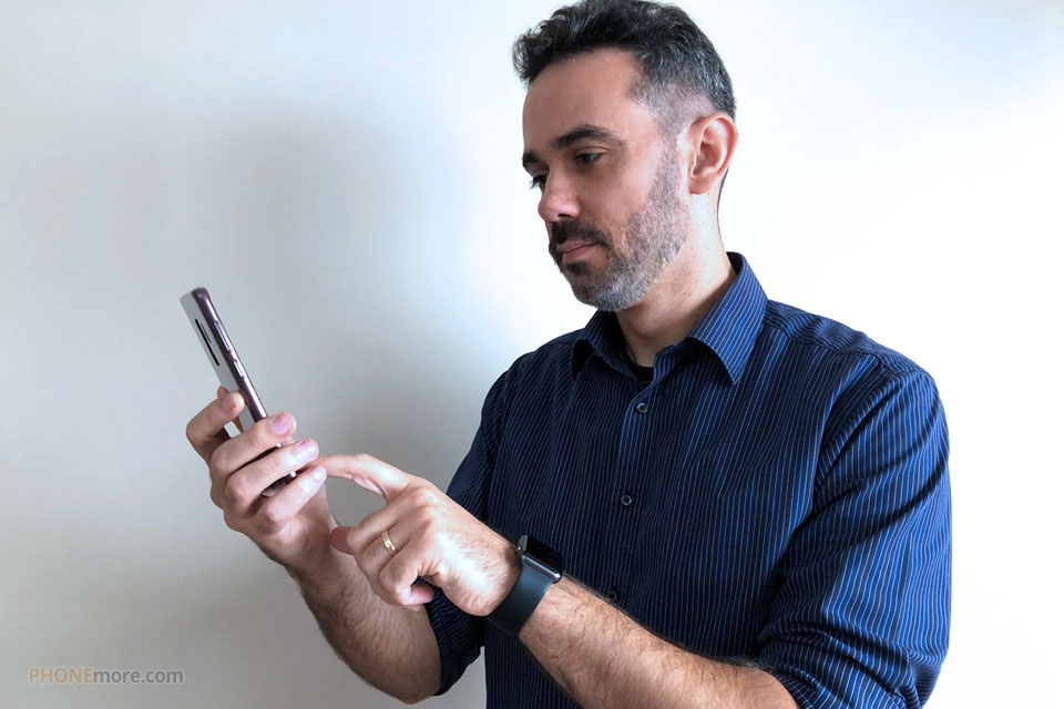 executive man holding the smartphone