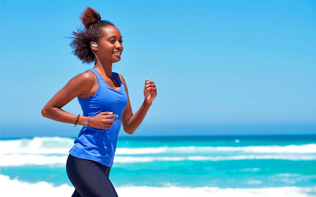 black woman running with headset