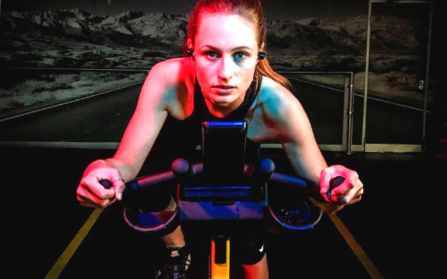 blonde woman on exercise bike