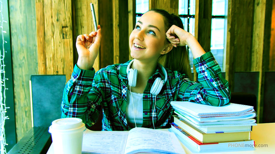 student girl with a pen in hand