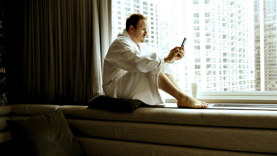 man with bathrobe in his apartment