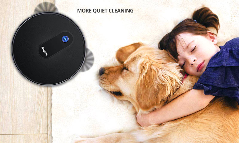 girl hugging a dog lying on the carpet while the robot vacuum cleaner is cleaning