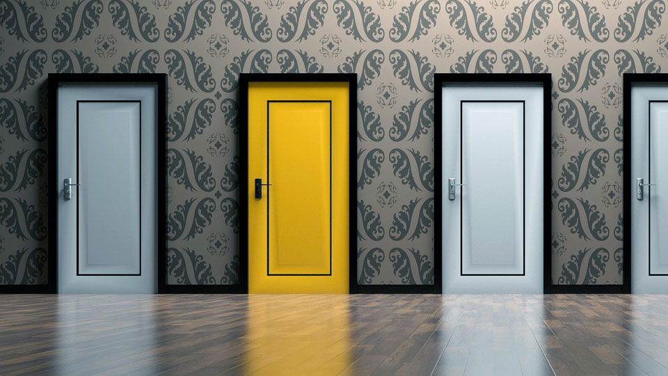 three white doors and one yellow door