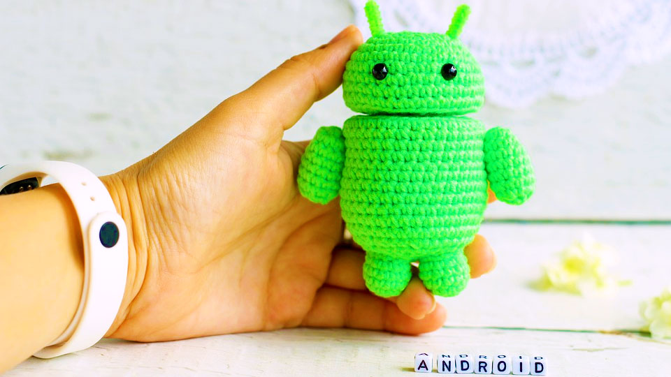 hand holding an android knitting robot