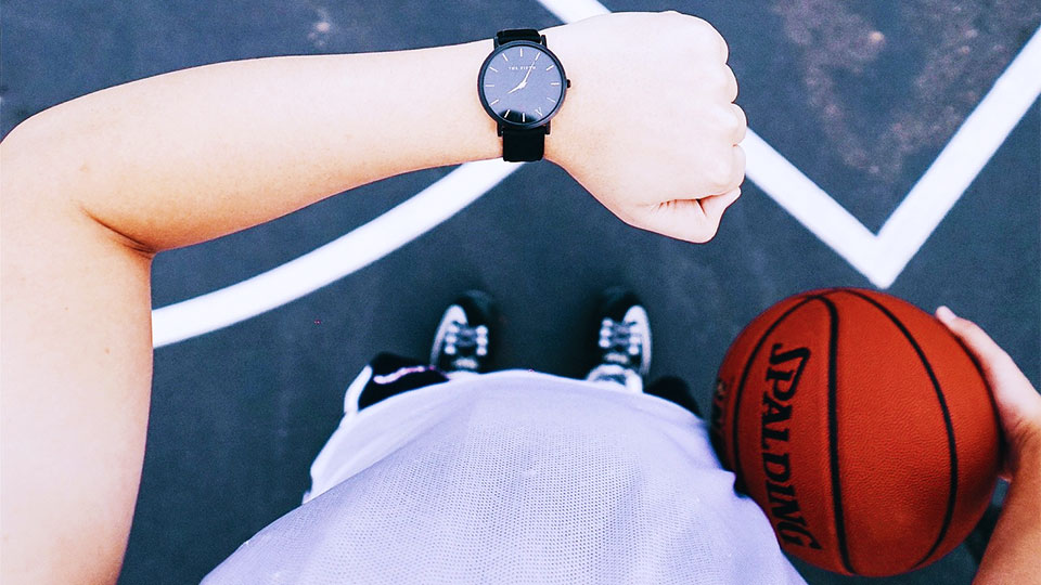 watch on the arm of a basketball player