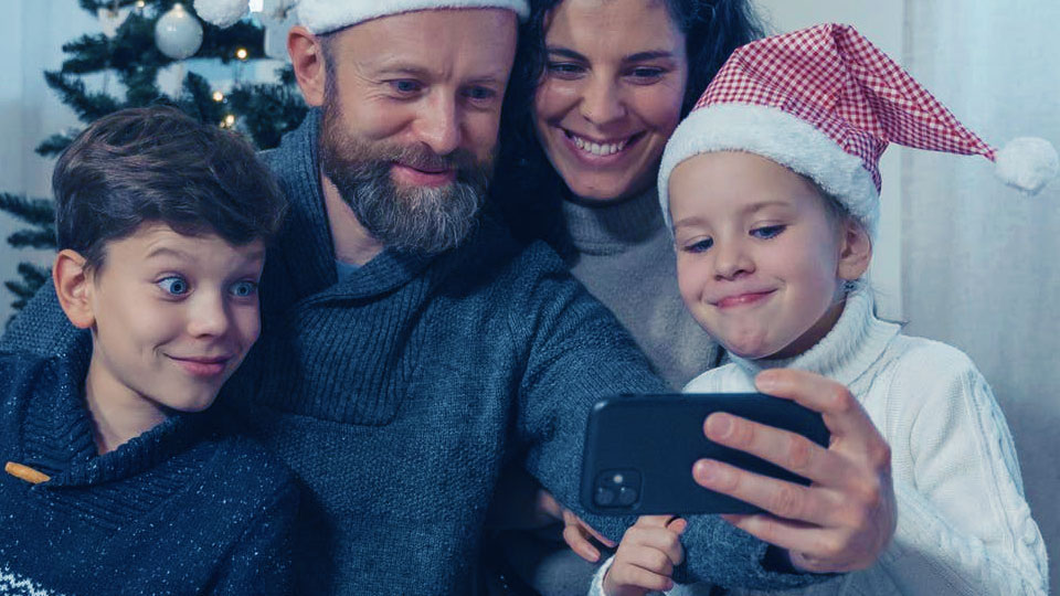 family taking a selfie at christmas