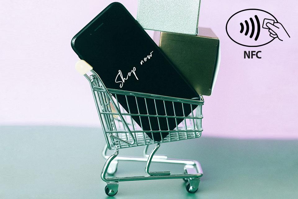 a smartphone inside a miniature shopping cart