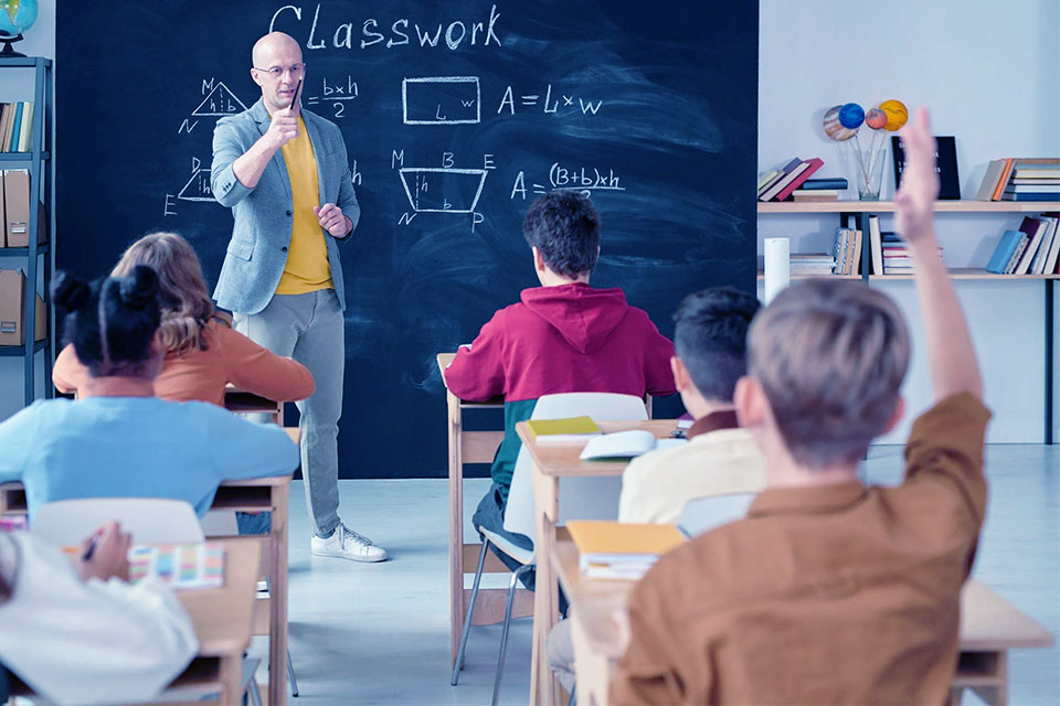 a teacher in the classroom with students