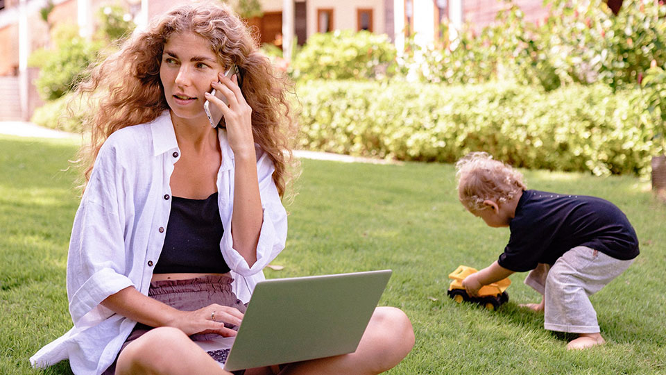 woman sitting in the garden making a phone call