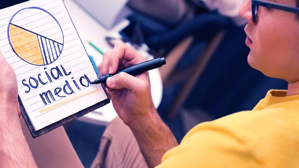 a person with a pen and clipboard written social media