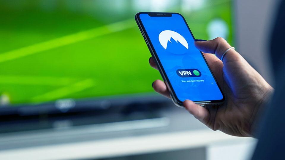smartphone in hand accessing vpn