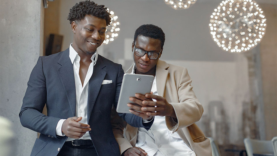 2 businessmen looking at the tablet