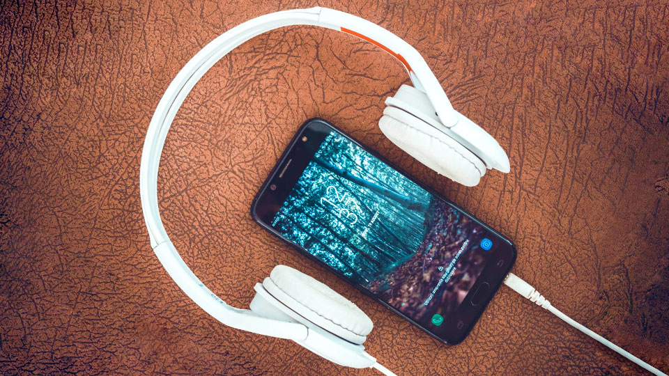 a smartphone with a white headset