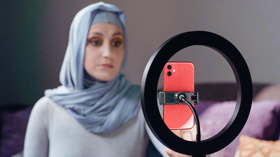 woman recording a video with her cell phone