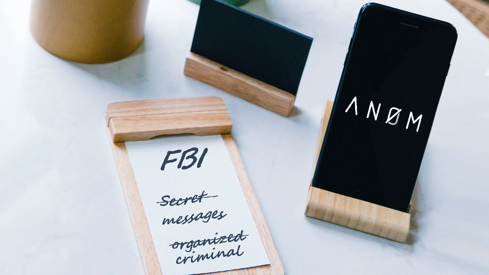 anom app on a smartphone screen on the table