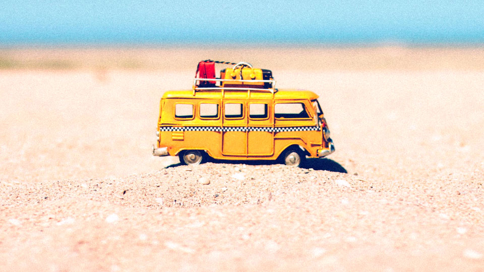 toy kombi with suitcases on top